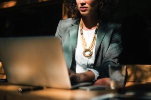 woman sat at computer